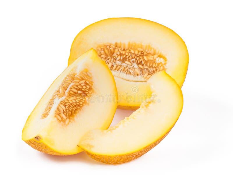 Coupe en tranches le melon jaune de jus avec des graines d'isolement au-dessus du backgro blanc photo stock
