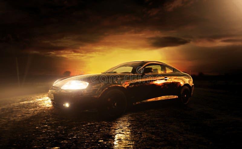 Coupe hyundai спортивной машины в заходе солнца стоковое изображение rf