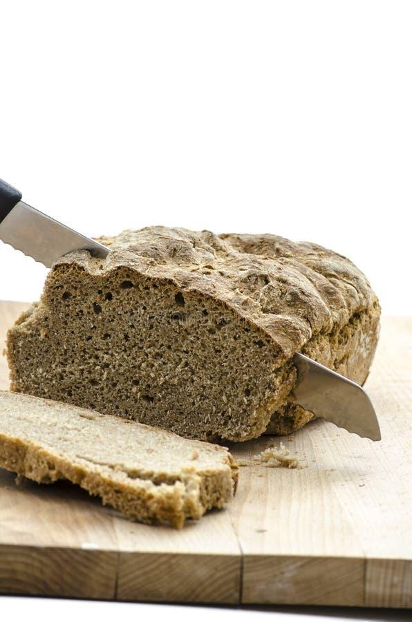 Couper un pain images stock