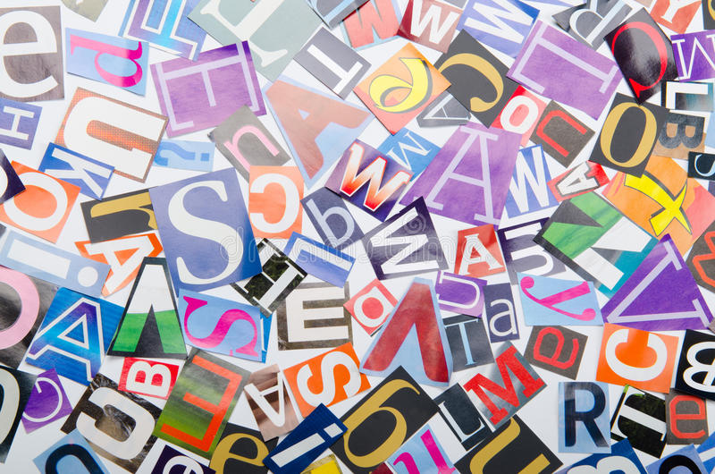 Coupez les lettres des journaux images stock
