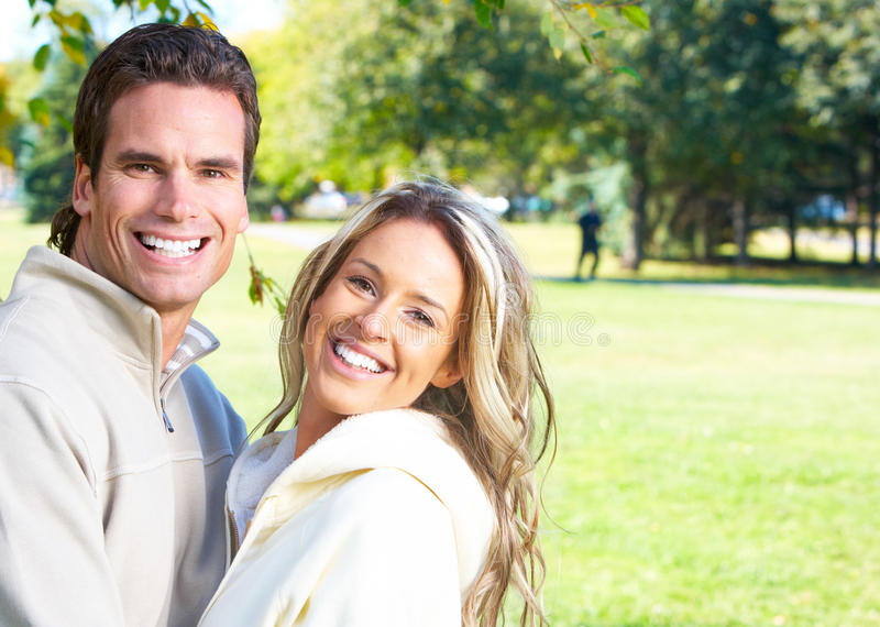 Couple. Young love couple smiling in park royalty free stock photo