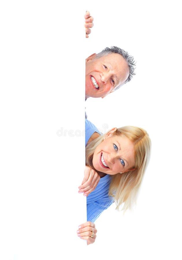 Couple. Happy seniors couple holding a white placard stock image