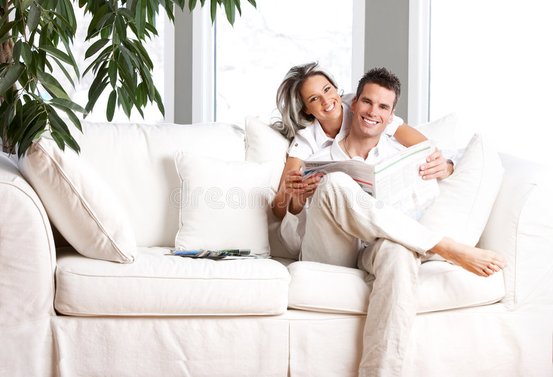 Couple. Young love couple reading magazine in the comfortable apartment