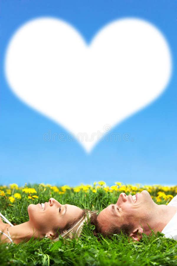 Couple. Young love couple dreaming on green grass