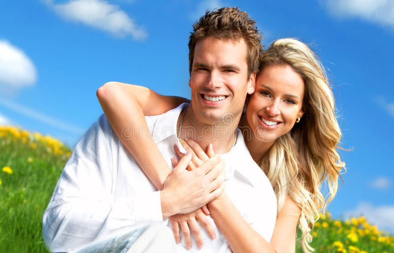 Couple. Young love couple smiling under blue sky