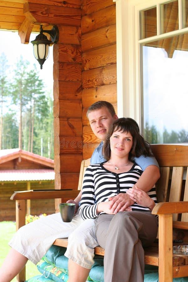 Couple. Young couple drinking tea on verandah royalty free stock photo