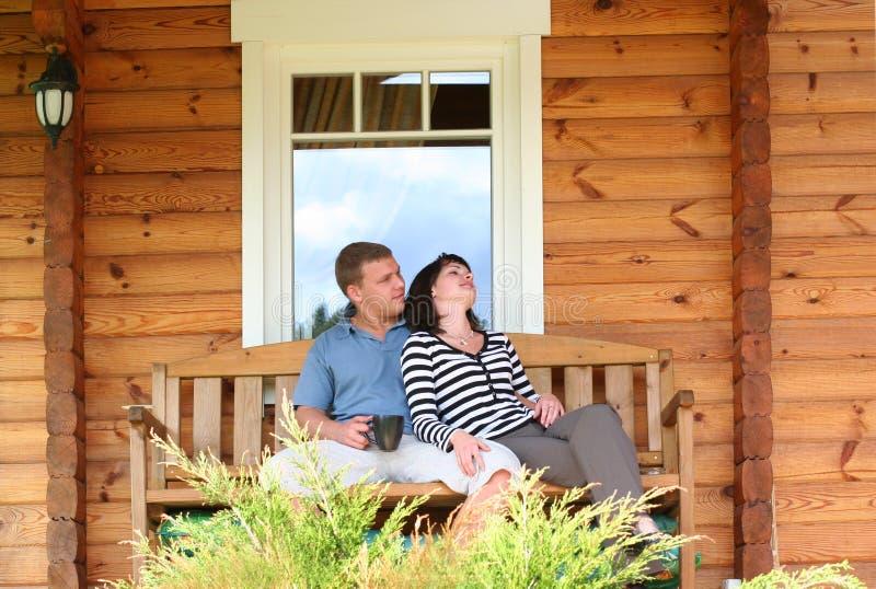 Couple. Young couple drinking tea on verandah stock photos