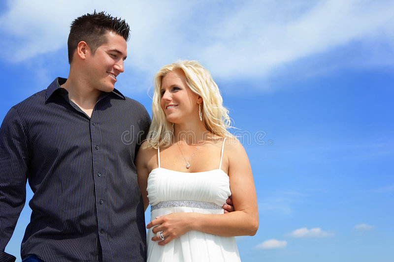 Couple. Happy couple walking. Oposite blue sky royalty free stock photography