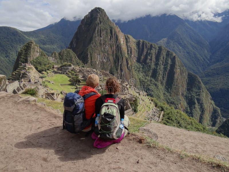 Couple admiring Machu Picchu royalty free stock photography