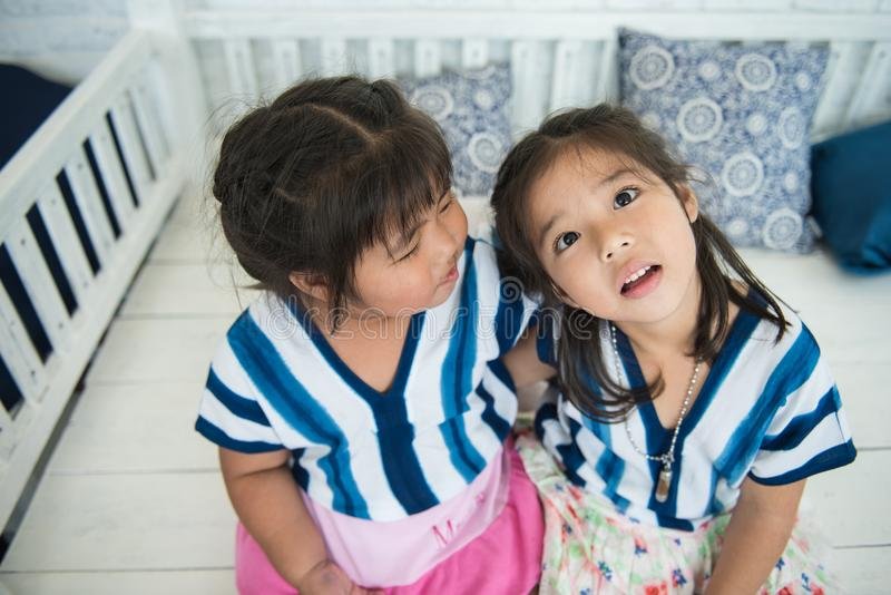 a couple of adorable sisters making funny face royalty free stock photo