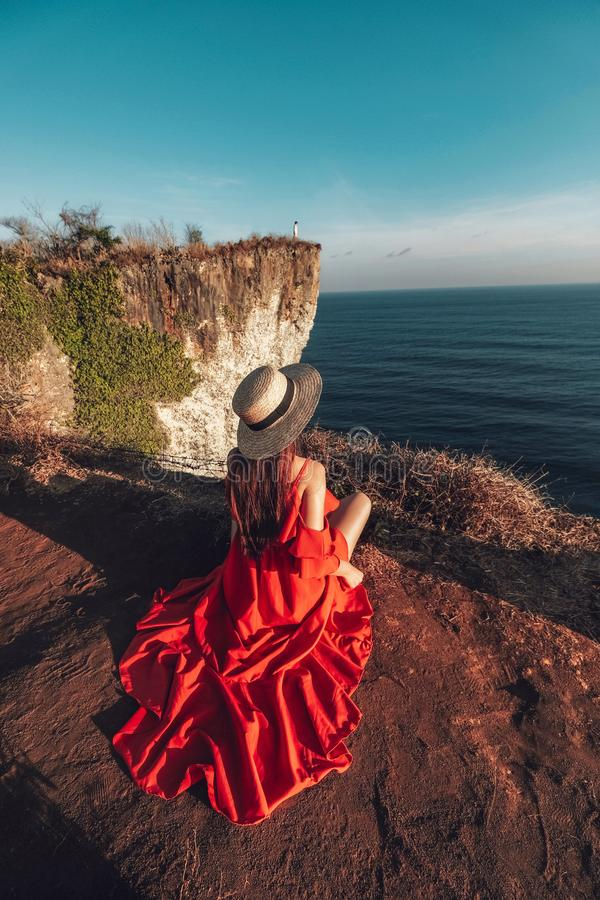 Couple Adventure and looking view on the karang boma cliff at Uluwatu Bali in Indonesia stock image