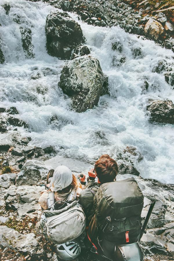 Couple adventurers relaxing at mountain river together. Love and Travel Lifestyle wanderlust concept adventure vacations outdoor stock photos