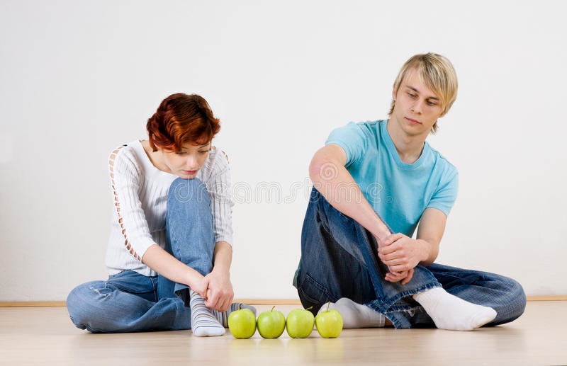 Couple with apples stock photos