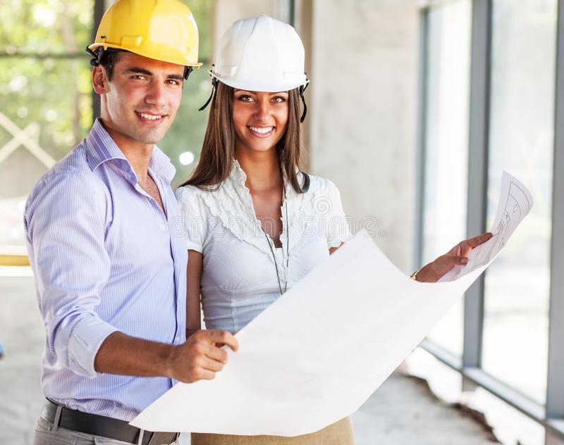 Couple of architects on construction site. royalty free stock photos
