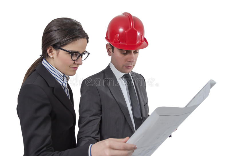Couple of architects revising a house project on white background stock image