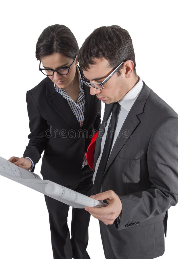 Couple of architects revising a house project on white background stock photo