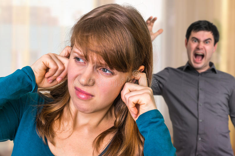 Couple arguing, angry man screaming at his wife at home. Couple arguing at home, angry men screaming at his wife royalty free stock photography