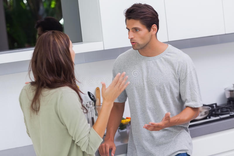 Couple arguing in the kitchen royalty free stock photo