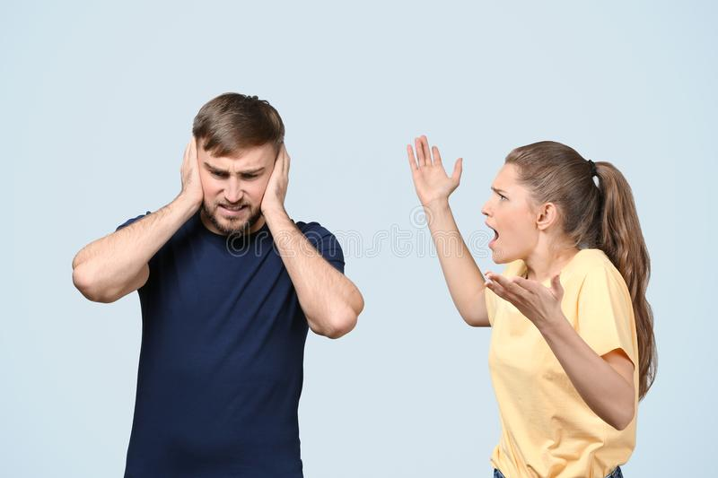 Couple arguing on light background. royalty free stock images