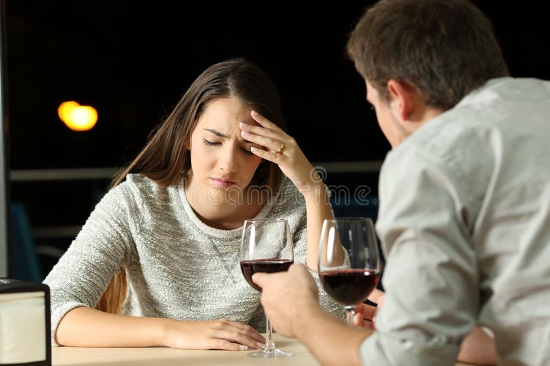 Couple arguing in a restaurant in the night stock photography