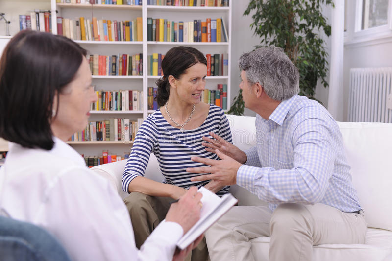 Couple arguing during therapy session. With psychologist royalty free stock images