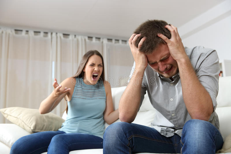 Couple arguing with wife shouting royalty free stock photo