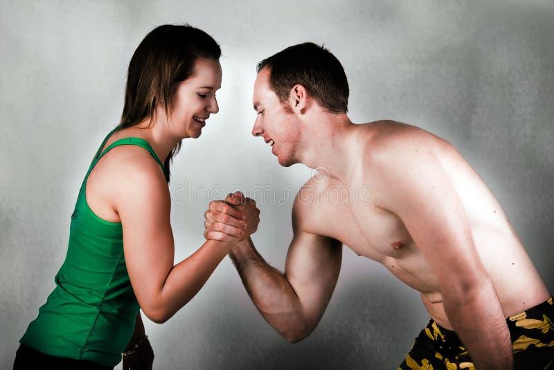 Couple arm wrestling stock photography
