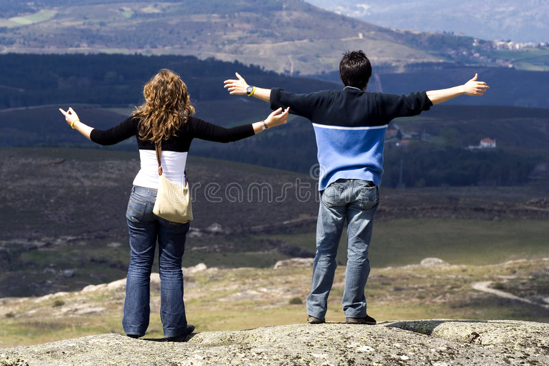 Download Couple with arms wide open stock photo. Image of mountains - 2933904