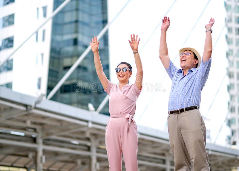 Couple of Asian old man and woman tourist are acting as exciting and very happy. This photo also contain concept of good life of stock image