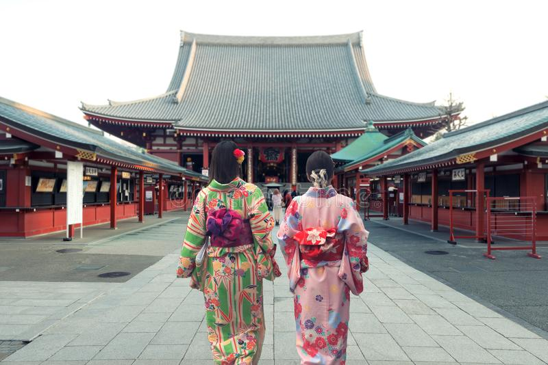 Couple asian women wearing traditional japanese kimono in Sensoji temple in Tokyo, Japan. royalty free stock images