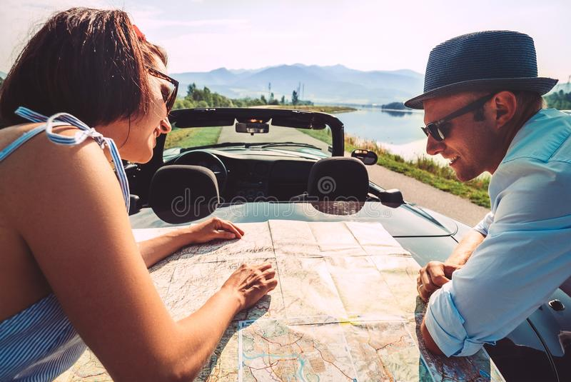 Couple auto travelers plans itinerary stock photography