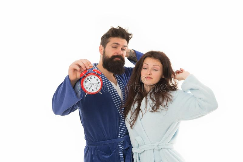 Couple awakening hold alarm clock. Family morning routine. Create healthy rest regime to sleep enough. Good morning. Morning wake up. Harmful habit to royalty free stock photo