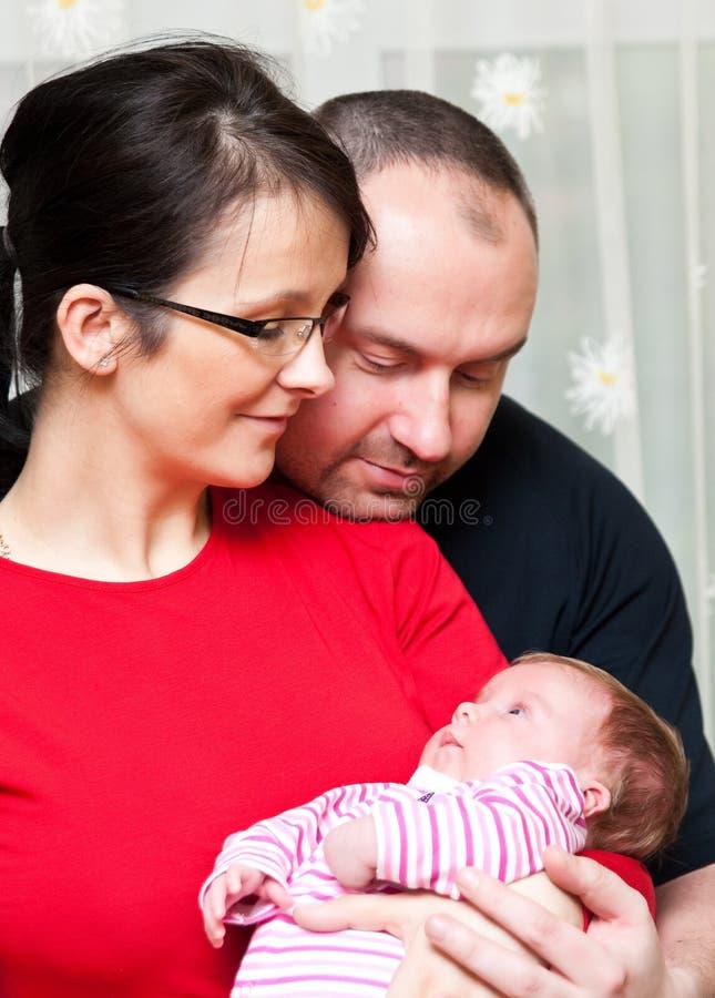 Couple with baby girl stock image