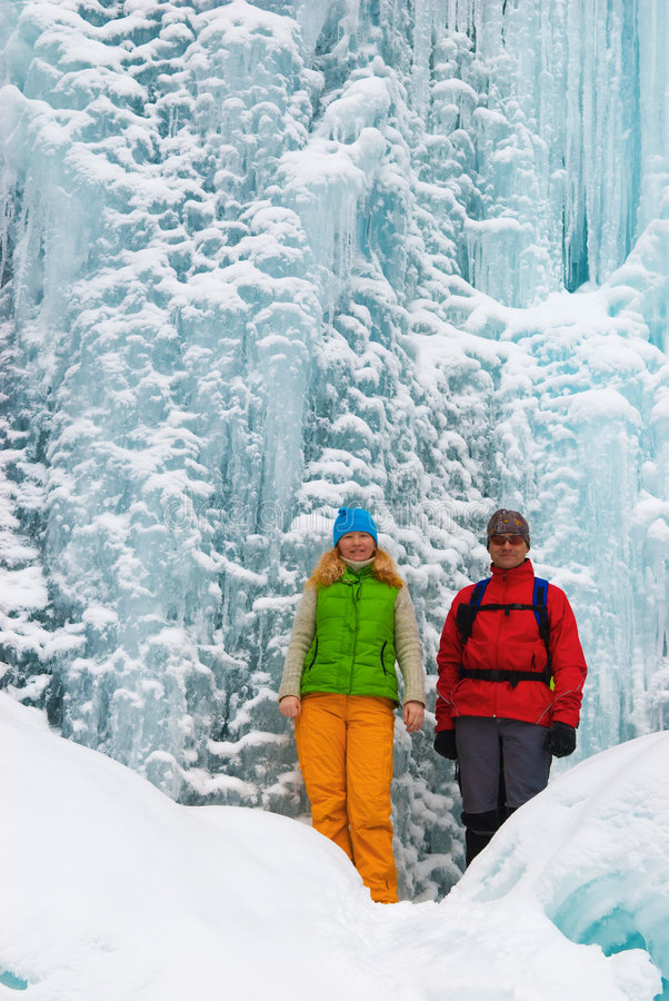 Download Couple Backpackers And Ice Waterfall Stock Photo - Image: 6862448