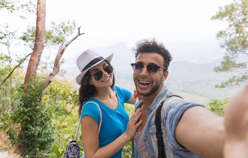 Couple With Backpacks Take Selfie Photo Over Mountain Landscape Trekking, Young Man And Woman On Hike Tourists. Adventure Activity royalty free stock photos
