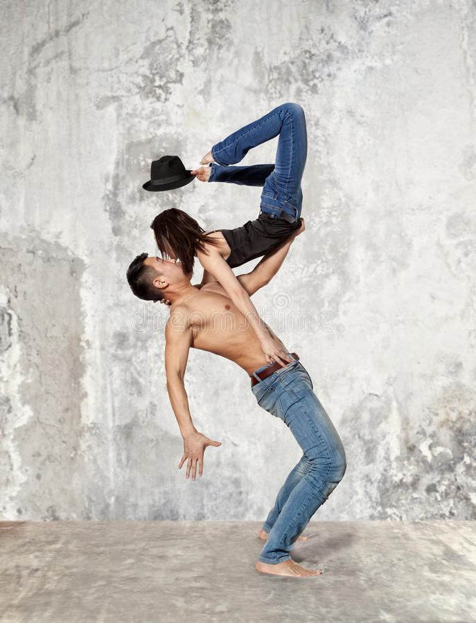 Couple ballet dancing on wall background stock photography