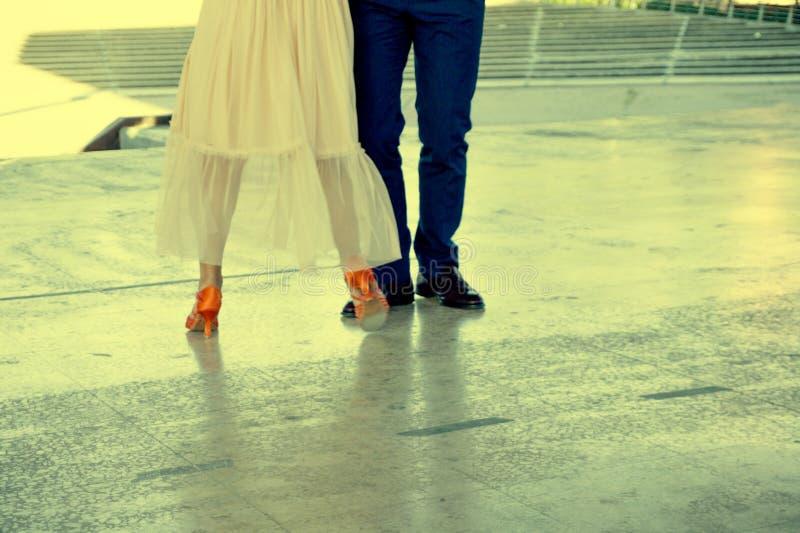 Couple of ballroom dancers dancing. On a dance floor royalty free stock photos