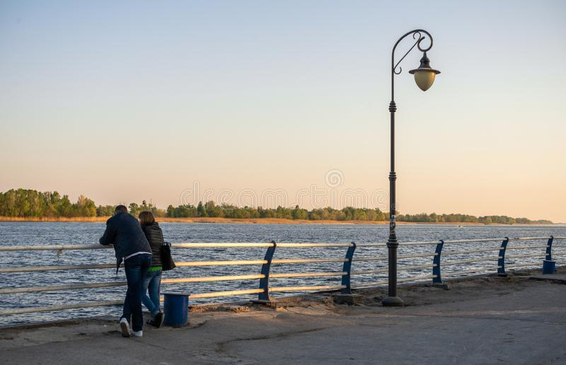 A couple on the banks of the Dnieper River in Kherson stock images