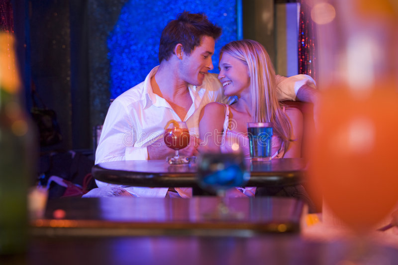 Couple In Bar. Having A Drink