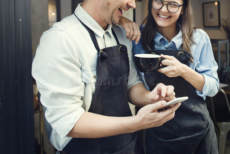 Couple Barista Coffee Shop Service Restaurant Concept. Couple Workers Drinking Coffee Concept stock photos