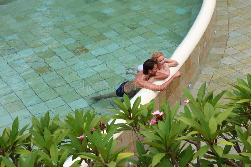 Download Couple Bathing In Hotel Pool Stock Image - Image: 22085563