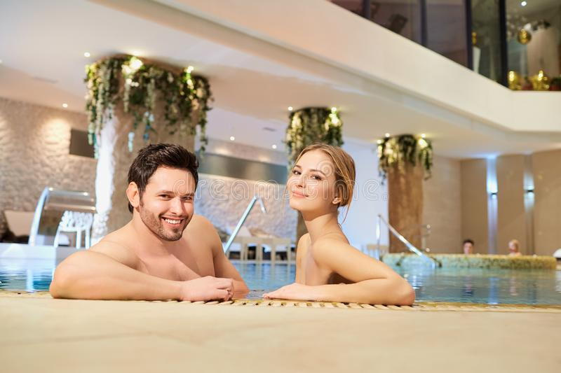 Couple in the pool resting spa center. royalty free stock image