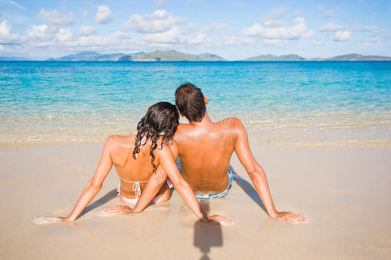 Couple beach. Couple relaxing on tropical beach with turquoise waters