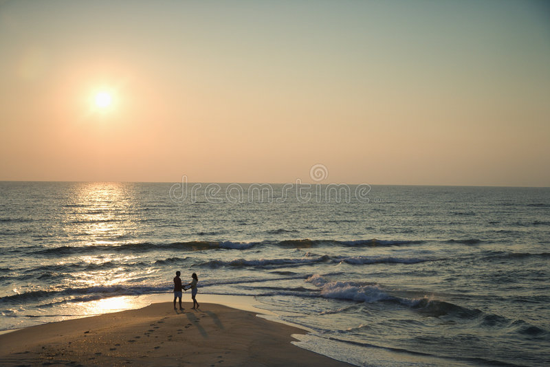 Couple on beach. stock images