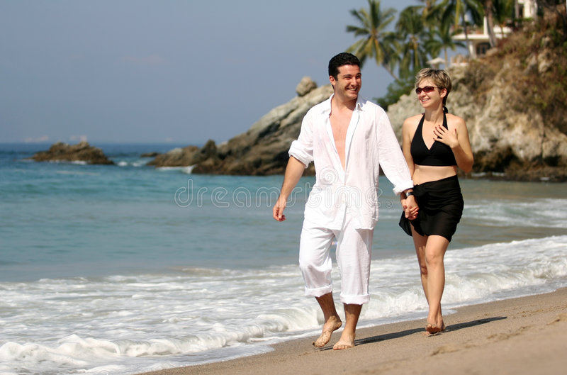 Couple on the beach. Young couple walking on the beach