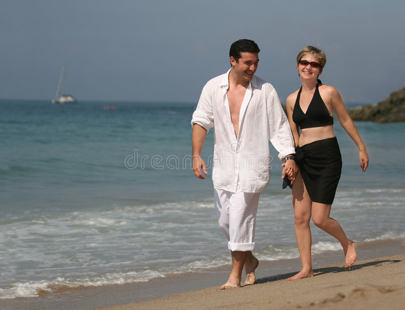 Couple on the beach stock photo