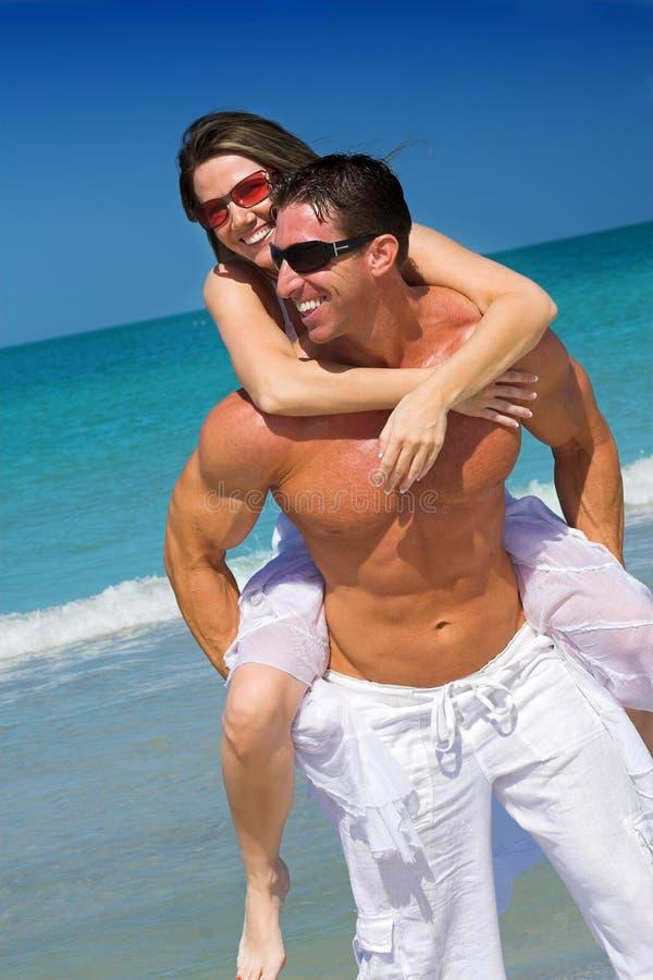 Couple at beach. Happy couple having fun at the beach