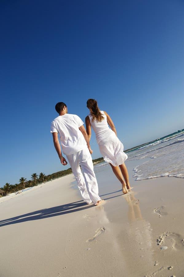 Couple on beach royalty free stock photos