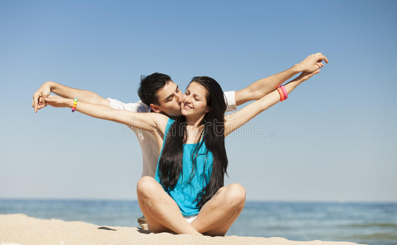 Couple on the beach. Beautiful couple on the beach. Summer time photo royalty free stock photo
