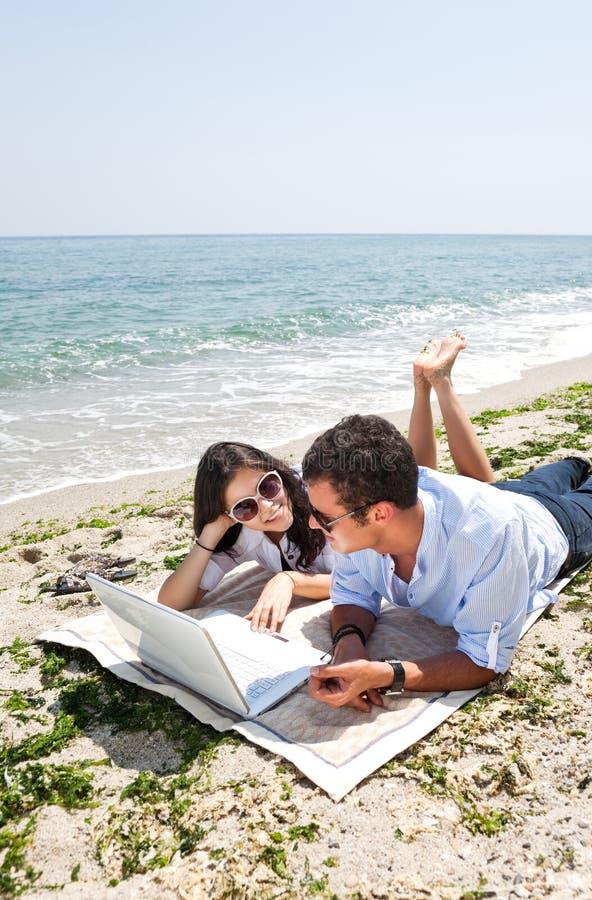 Couple beach communication stock photography